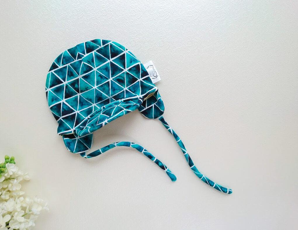 Poiste tumeroheline tumesinine meriinovillane beebimüts nokaga ja paeladega käsitöömüts poisile