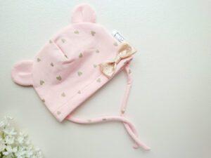 Lõheroosa, pastellroosa tüdrukute suvemüts paeltega, lipsudega ja pisikese lipsuga
